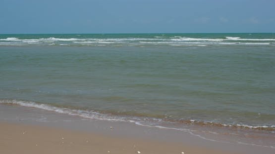 Water wave on sand beach