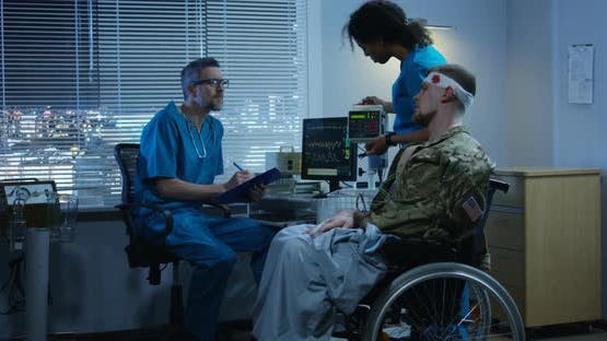 Soldier Sitting in Wheelchair Among Doctors