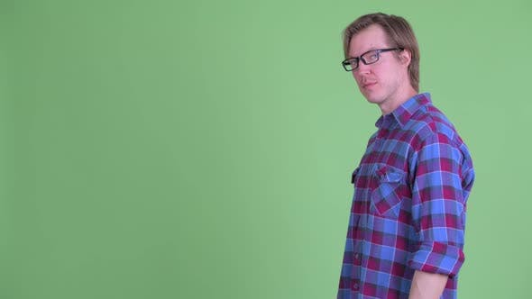 Cover Image for Profile View of Young Handsome Hipster Man Looking at Camera