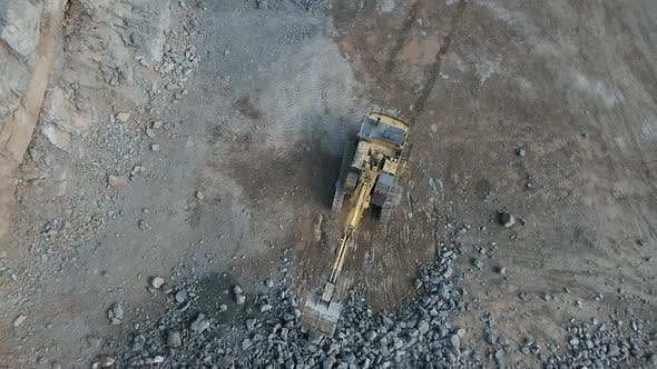 Thumbnail for Rising Bird's Eye View of a Digger Working in a Quarry