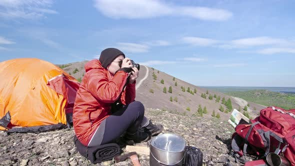 Cover Image for Female Camper Taking Pictures of Mountains with Camera
