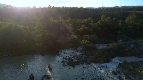 Cover Image for River Among Deep Tropical Jungle Aerial Panorama