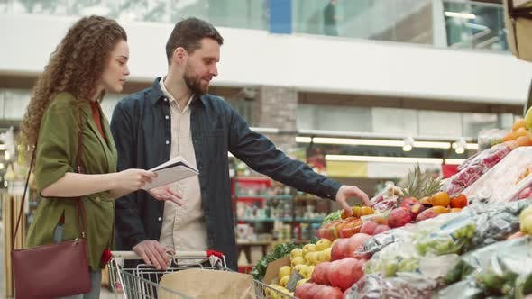 Thumbnail for Young Spouses Shopping in Grocery Store