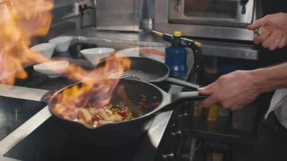 Cooking Vegetables On Fire