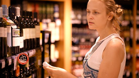 Thumbnail for Woman Shopping For Alcohol In A Bottle Store