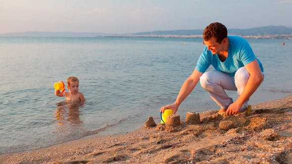 Thumbnail for Father Playing With His Son At The Beach