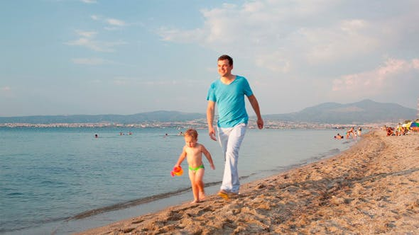 Thumbnail for Father And His Son Walking On The Beach
