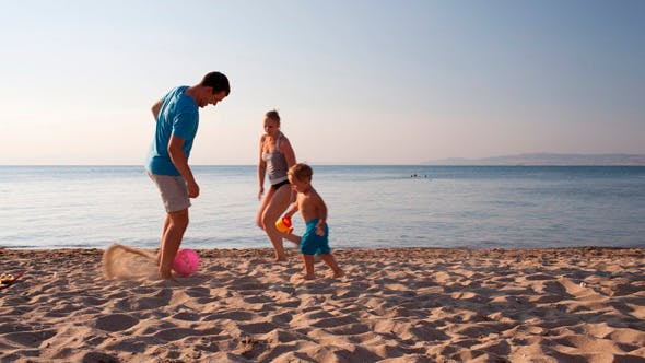 Thumbnail for Young Family Playing Football On The Beach