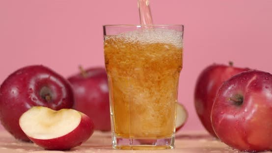 Pour the Apple Juice Into a Glass.