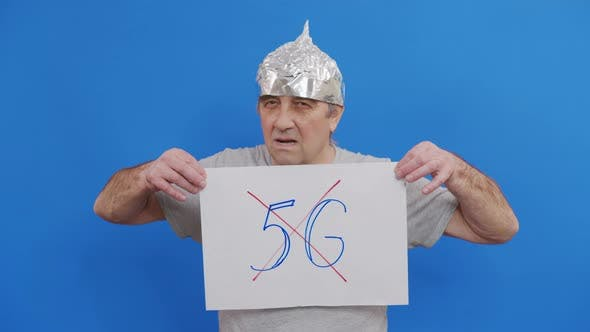 Man Holding Placard with No 5g Sign. Protesting Against 5G Technology and 5G-compatible Antenna
