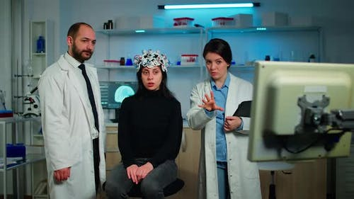 Team of Medical Researchers Testing Nervous System of Woman Patient