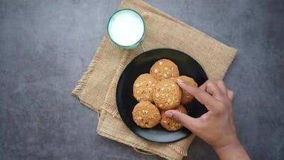 Hand Pick Whole Meal Cookies on Black Background