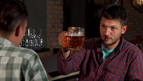 Thumbnail for Mature Bearded Man Talking To His Friend While Drinking Beer at the Pub