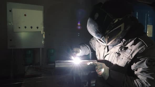 A Production Worker Welds Metal Structures By Argon Welding