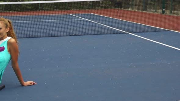 Thumbnail for Tennis Girl Having a Rest on Court