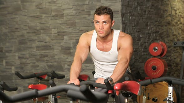 Thumbnail for Muscular Man Doing Bike Training