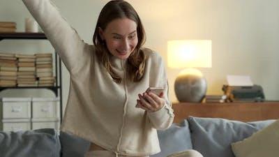 Woman Getting Good News Notification Via Mobile Phone
