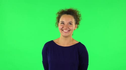 Portrait of Curly Woman Sbursting with Laughter Being in Positive. Green Screen