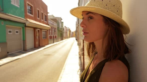 Thumbnail for Model Leaning on Wall with an Empty Street in the Background