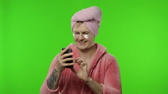 Thumbnail for Portrait of Transsexual Man in Bathrobe Using Mobile Phone for Chatting, Working