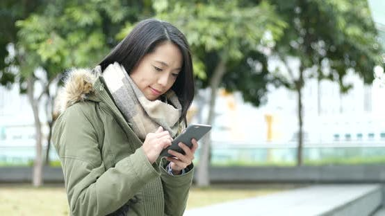 Thumbnail for Woman use of mobile phone in the city
