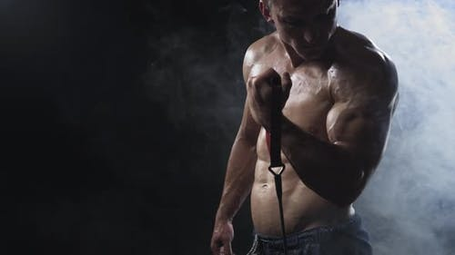 Muscular Man Exercising with Resistance Band