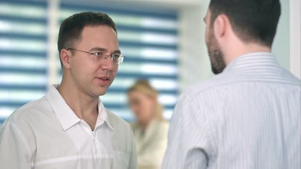 Thumbnail for Confident Male Doctor Talking To Male Patient