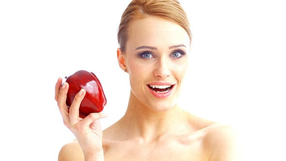 Thumbnail for Beautiful Blond Woman Eating Red Apple