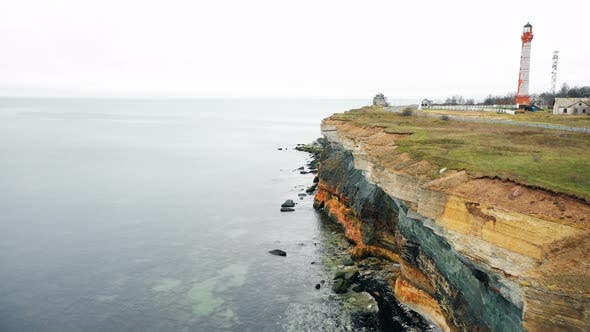 Thumbnail for Incredible Aerial Tracking Shot of Amazing Eroded Rocky Sea Shore with Waves Crushing Stone Layers