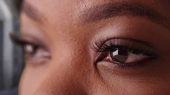 Thumbnail for Close up of young black woman's eyes blinking