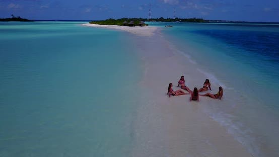 Thumbnail for Beautiful happy ladies on vacation enjoying life at the beach on summer white sandy and blue backgro
