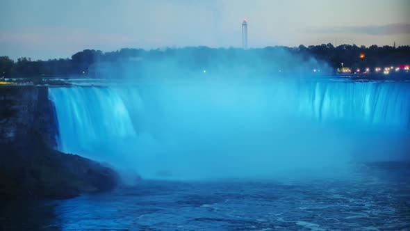 Thumbnail for Day To Night Timelapse: Niagara Falls in the Form of a Horseshoe. It Is Illuminated By Lights