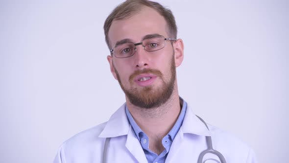 Thumbnail for Face of Happy Bearded Man Doctor Talking To Camera