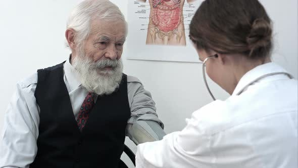 Thumbnail for Doctor Measuring Blood Pressure of Male Patient