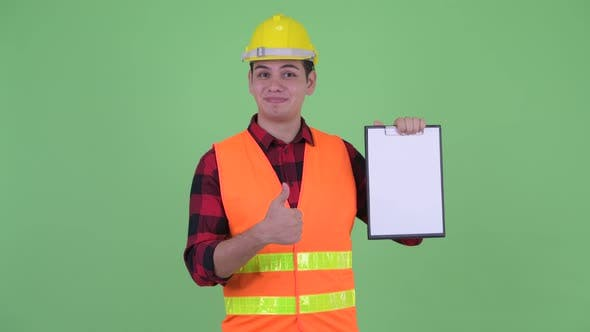 Thumbnail for Happy Young Multi Ethnic Man Construction Worker Showing Clipboard and Giving Thumbs Up
