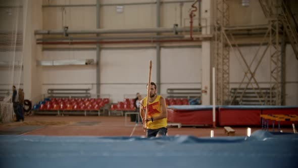 Pole Vaulting - Man in Yellow t Shirt Is Configuring To Jump