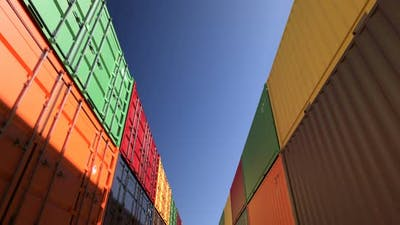 Rows of Shipping Containers Under Clear Sky