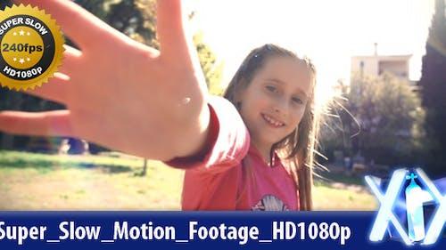 Young Girl Waving At Camera