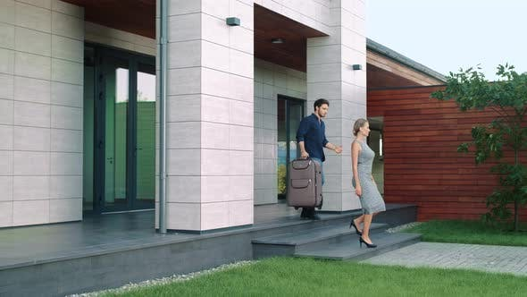 Thumbnail for Business People with Luggage Leaving Luxury House