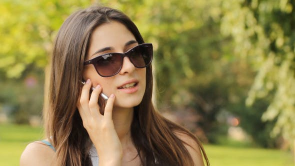 Thumbnail for Girl Talking On A Cell Phone After Shopping