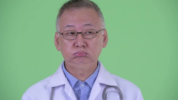 Thumbnail for Face of Stressed Mature Japanese Man Doctor Looking Bored and Tired