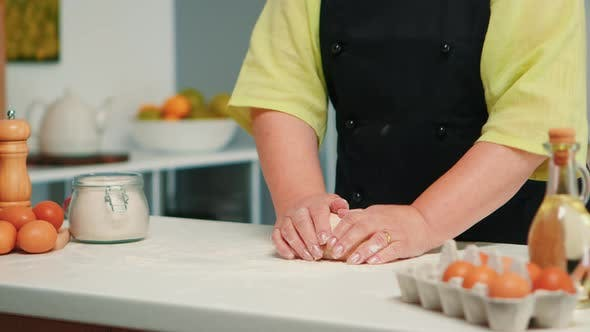 Thumbnail for Woman Hands Kneading Dough on Table