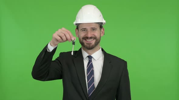 Ambitious Engineer with House Key and Money Against Chroma Key