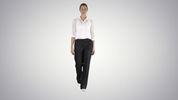 Thumbnail for Glamour business woman walking with hands in her pockets