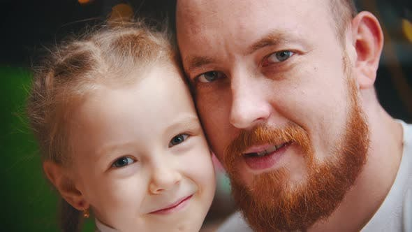 Caucasian Family - a Dad and Daughter - a Man with Ginger Beard