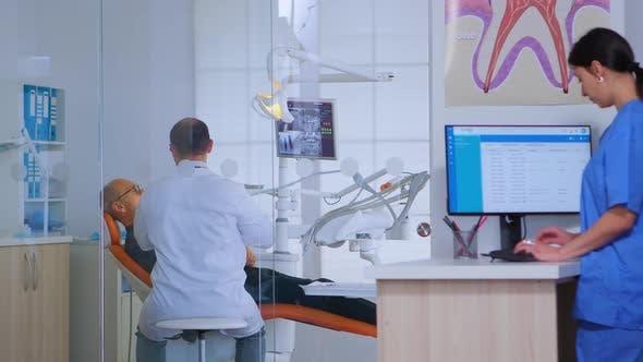 Thumbnail for Patients Asking for Help Filling in Dental Registration Form