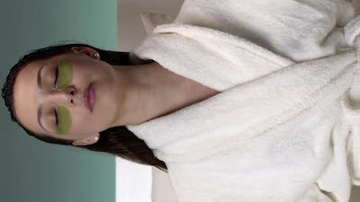 Vertical Shot Beautiful Woman with Patches on Face Meditates in Bed Before Going to Bed