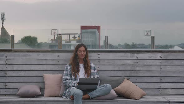 Thumbnail for Woman Working on Computer Outdoors