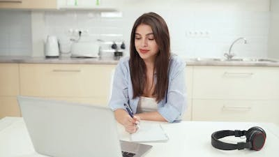 Young Beautiful Woman Studying Online with Laptop