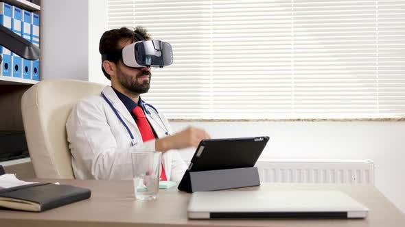 Thumbnail for Doctor in His Office Using a VR Virtual Reality Headset